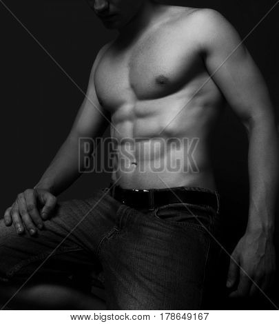 Young man with sexy abdomen muscles