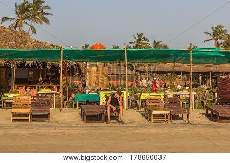 ARAMBOL BEACH GOA INDIA - FEBRUARY 23 2017: Young man on Arambol beach at sunset in Goa India on February 23 2017.
