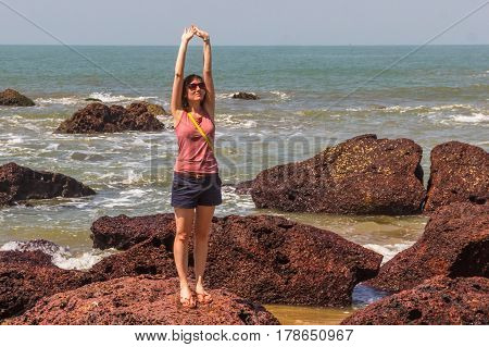 Young Woman On The Coast Of The Arabian Sea, Indian Ocean, North Goa, India