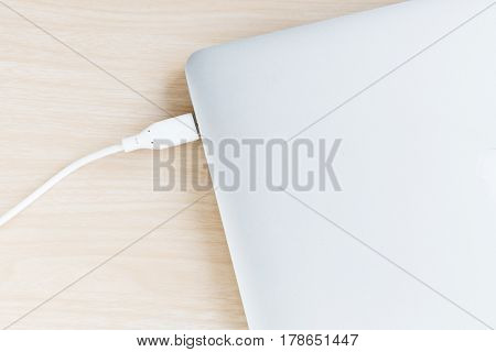 External hard drive connect to laptop to backup and storage data on nature wood background