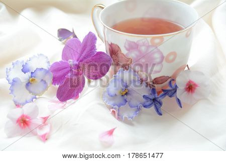 tea with flowers and uplifting spring mood