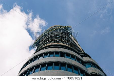 Madrid Spain - September 18 2016: Low angle view of Capitol building at Gran Via Street in Madrid. It is an important street in Central Madrid with shops and theaters.