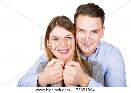 Picture of a cute loving couple posing on an isolated background