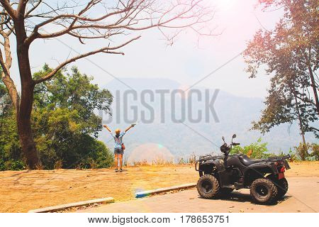 Young happy traveler with hill landscape, Happy journey