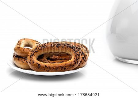 Whole bagels with poppy seeds on a plate. Sweet bread. isolated