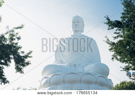 White Buddha Statue at Long Son Pagoda. Big Buddha Statue in Nha Trang Vietnam. Sunny day blue sky