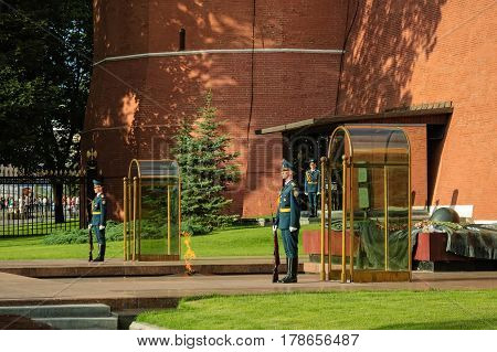 Moscow, Russia - July 4, 2005: Changing guard soldiers in Alexander's garden near eternal flame at the Tomb of the Unknown Soldier