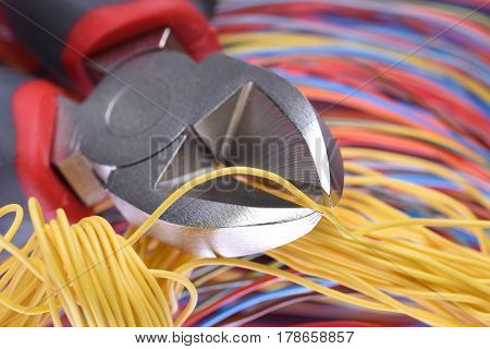 Electricial  Pliers and Colorful Cables Close-up