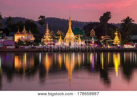 Lake with Wat Chong Klang and Wat Chong Kham temples on sunset, Mae Hong Son, Thailand