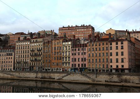 Lyon, France - December 20, 2016: houses on Embankment St. Vincent. River Saone (Sona) in December 20 2016 in Lyon, France
