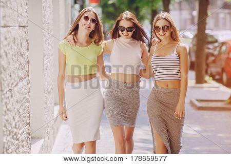 three beautiful girls walking around the city