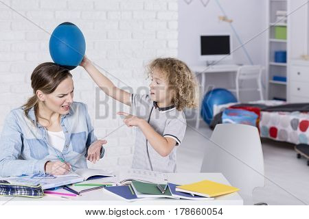 Boy Bothering His Mother