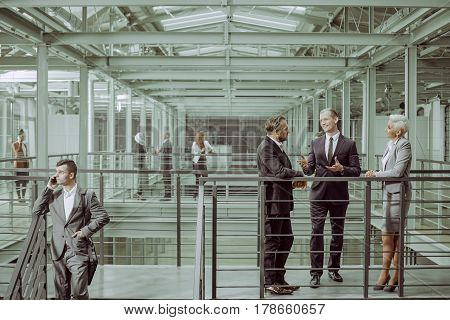 Business partners negotiating conract talking in office building