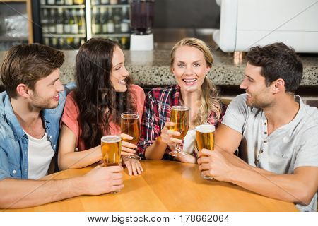Friends drinking beer at a bar