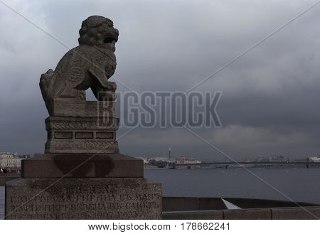St. Petersburg, Russia - March 25, 2017: Chinese lion guard on the embankment of the Neva River in the historical center of the city. St. Petersburg. Russia in March 25 in St. Petersburg, Russia