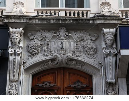 Lyon, France - December 20, 2016: Old door decorated with a sculpture in antique style in the historic center of the city in December 20 in Lyon, France