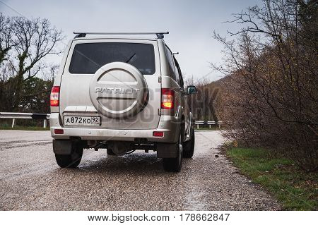 Rear View Of Silver Gray Uaz Patriot