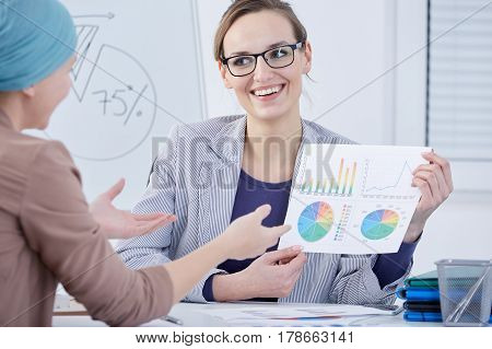 Doctor With Diagrams And Charts