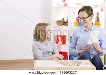 Girl And Speech Therapist