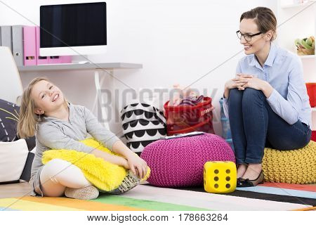 Little Girl And Psychologist Laughing