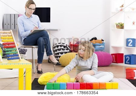 Psychologist Observing Little Girl