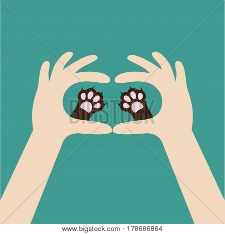 Two hands holding cute cat dog paw print. Love and care pet animals. Helping hand concept. Adopt donate. Flat design. Green background. Template. Vector illustration