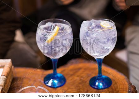 Two Gin Tonics In Wide Glass Blue Cup