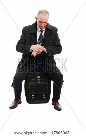 Middle Age Business Man Checking Time Sitting On Luggage