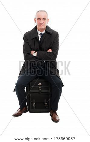Middle Age Business Man Sitting On Carry On Luggage