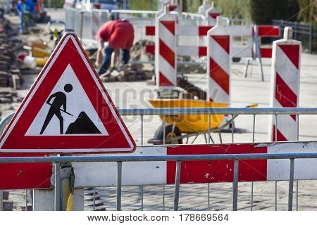 Road work and a work in progress sign