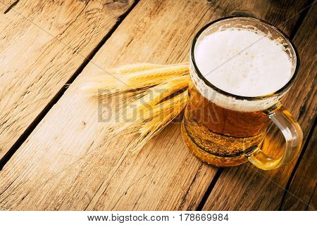 Glass of  beer on wooden table. wallpaper with copy space