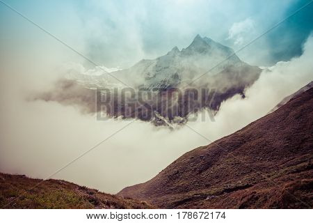 The Sacred Fishtail Mountain Revealing Through High Clouds. Annapurna Mountain Range, Himalayas, Nep