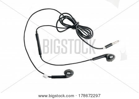 Black headphones with headset lie on white isolated background
