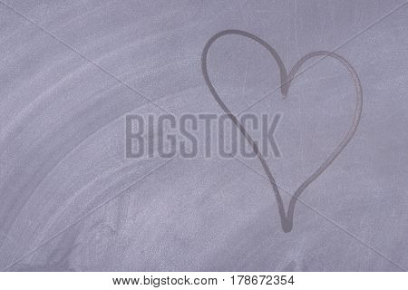 Black school board with a painted heart. Horizontal background board