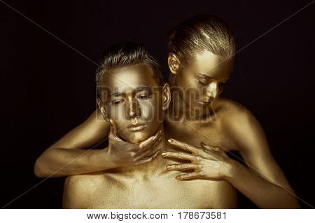 A girl and a boy, covered in gold paint. With my eyes closed. She bent down to him. Look in different directions. The fragmentation of interests