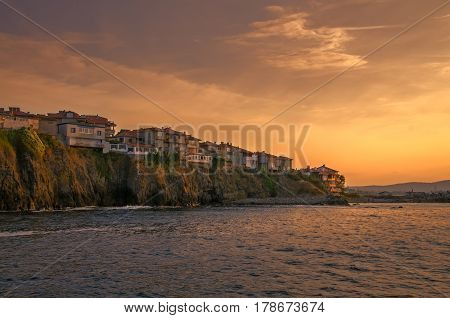 panoramic evening view of a small town on rock cliff at sunset in sozopol, bulgaria