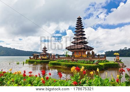 Temple Pura Ulun Danu Beratan. Traditional Balinese temple on lake. Place of festivals famous travel attraction day tour destination in Bali island Indonesia. Indonesian people culture background.