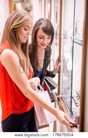 Two beautiful women shopping in a jeweler shop