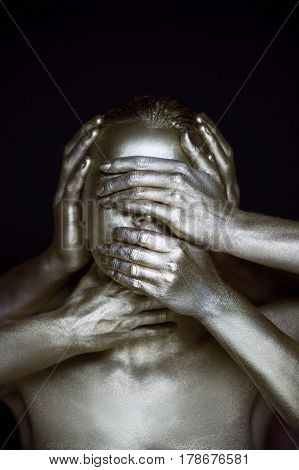 Girl painted silver. 6 hands on your face: see no evil, hear no evil, speak no evil.