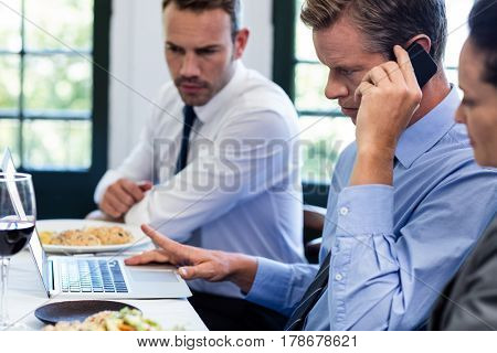 Businessmen discussing during a business lunch meeting in restaurant