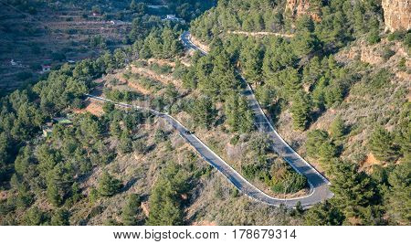 Long view of mountain with u-shape curved road