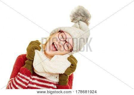 Happy young woman singing and wearing winter clothing with a cap and a scarf