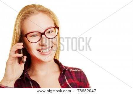 Smiling young blond woman calling with her smartphone