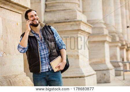 Young Man With Backpack Having Behind A Classic Building With Big Columns