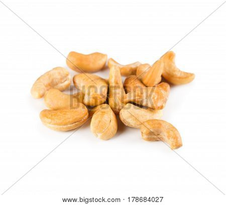 Pile of roasted peeled cashew close-up isolated on white background. Lots of peeled brown nut seeds, healthy vegan and vegetarian food