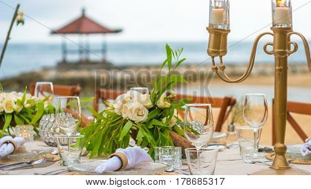 Close up of Table decoration in the Restaurant on the Beach. Bali
