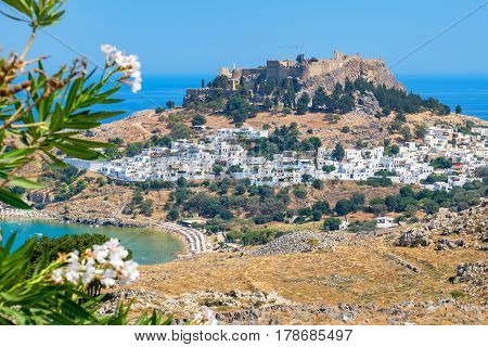 View of Lindos town and Acropolis. Rhodes Dodecanese Islands Greece Europe