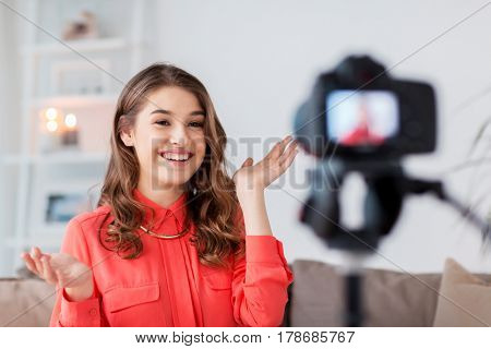 blogging, technology, videoblog, mass media and people concept - happy smiling woman or blogger with camera recording video at home