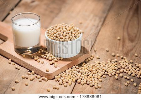 Soy Milk Or Soya Milk And Soy Beans On Wooden Table.