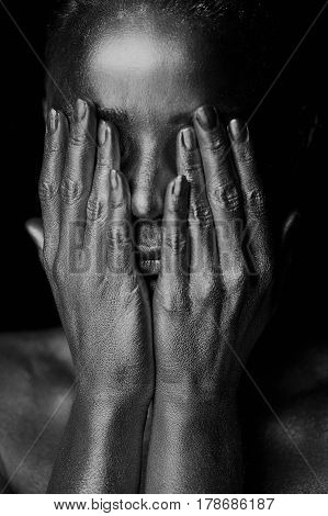 Portrait unearthly Golden girls, hands near the face. Very delicate and feminine. The eyes are closed.Black and white